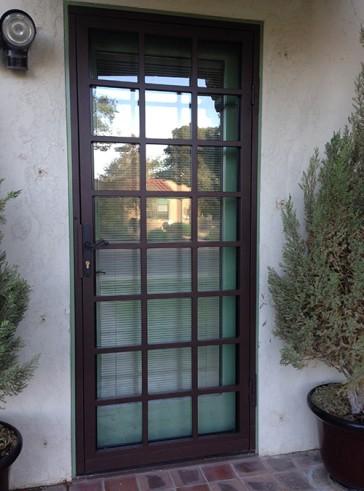 Security Storm Door in 1 inch divided light with slim line lock