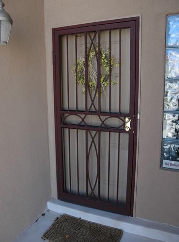 Security storm door with Iron Cross design