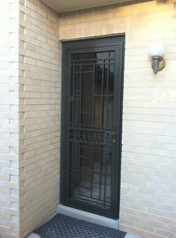 Security storm door with custom geometric design