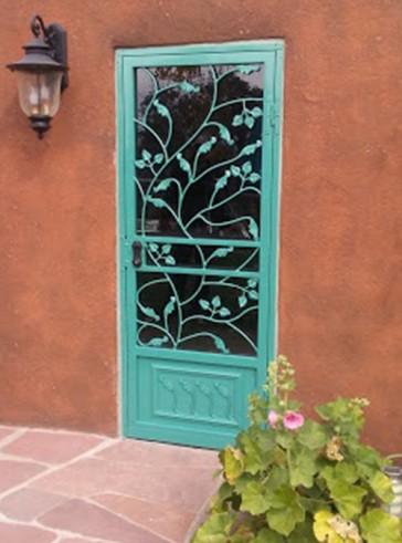 Security storm door in Leaves design with kick panel