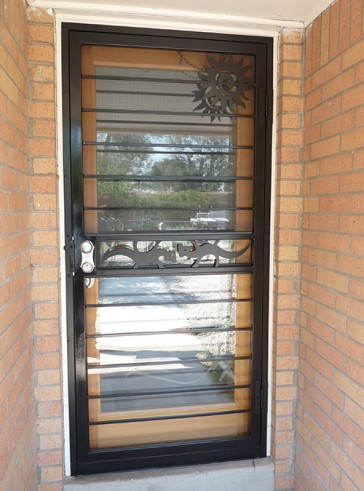 Security storm door with horizontal pickets, Geckos in center, and Swirl Sun design on top
