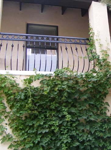 Balcony rail with Circles, Belly pickets, and Knuckles design