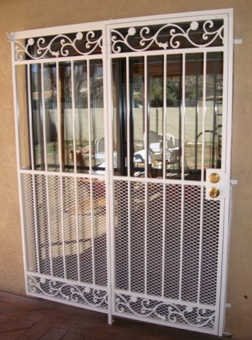 Patio door with Bellflower design and expanded metal on bottom