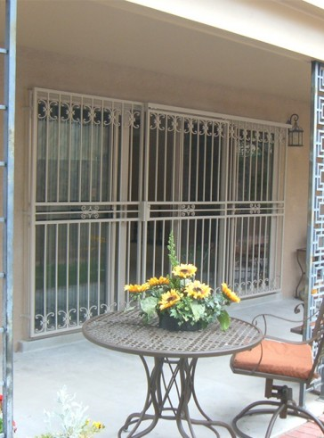 Sliding type patio door with medium C-scrolls design