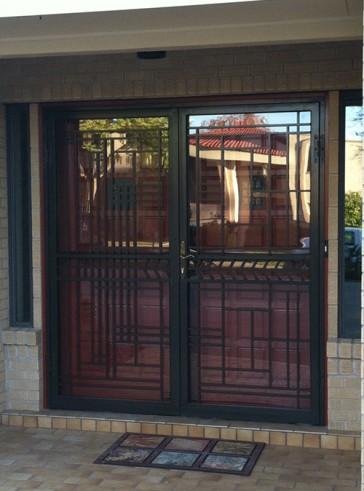 Pair of security storm doors in custom geometric design