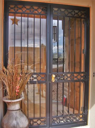 Pair of 8' high security storm doors in castle rock design