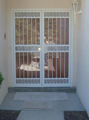 Pair of security storm doors in greek key design