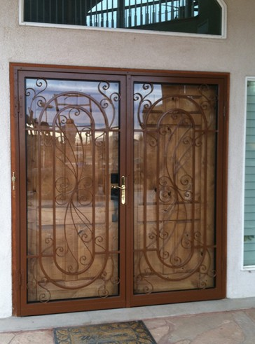 Pair of security storm doors with lovelady scroll design