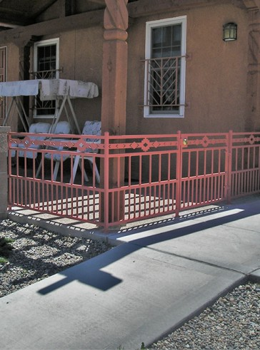 Railing and gate with doggie pickets and High Desert design
