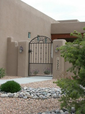Courtyard gate with Arched top with Wavy pickets, Collars and Baskets, and doggie pickets.
