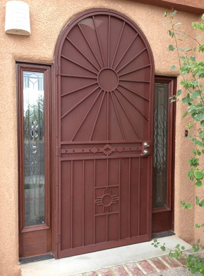 Arched 8' door with Upper Sun, High Desert, and Zia design on bottom with  perforated metal