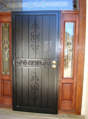 Security pre-hung door with Caprice and Center scroll design and perforated metal