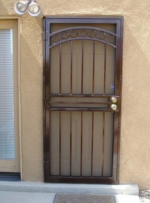 Security pre-hung screen door in arched top with Circles design