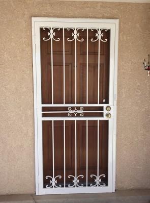 Security screen door with medium C scroll design