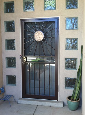 Security storm door with offset Sun with Copper and Forged bottom pickets