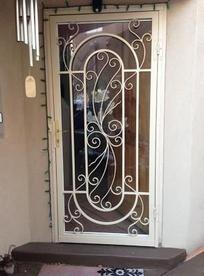 Security storm door in custom scroll design