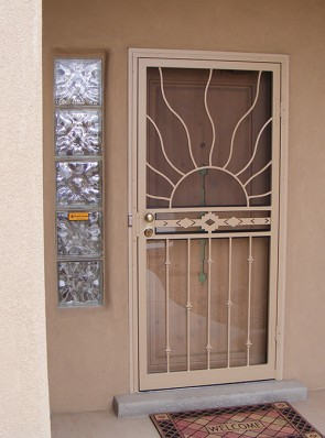 Security storm door with wave sun on top, High Desert in center, and knuckles on bottom
