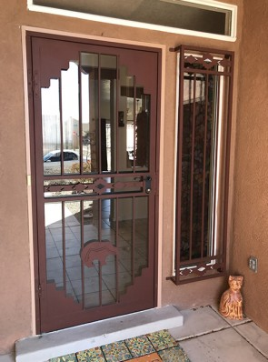 Security storm door in Pueblo design with Zuni bear on bottom