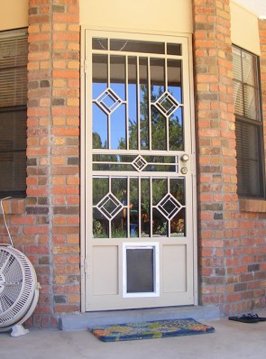 Security storm door in Diamond design and medium pet door