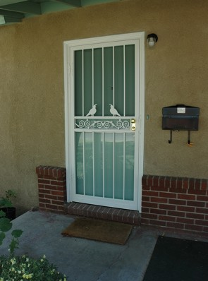 Security storm door with Quail and Center scroll design