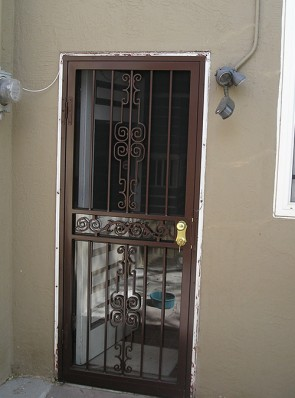 Security storm door in Regency design and brown