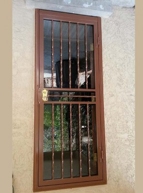 Security storm door in Twist pickets design