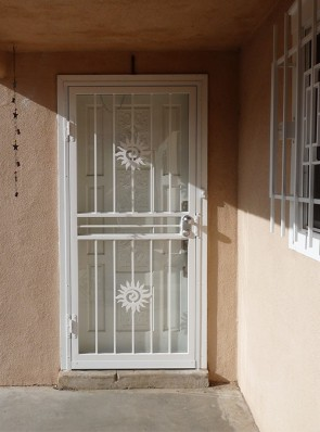 Security storm door in Swirl Sun design