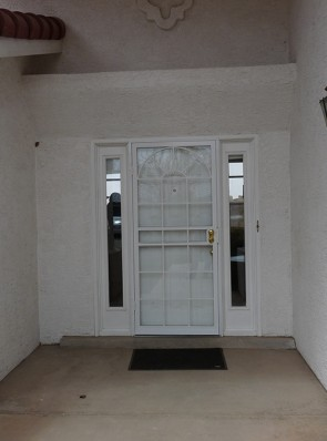 Security storm door in Arched top and divided light design