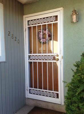 Security storm door in Greek Key design