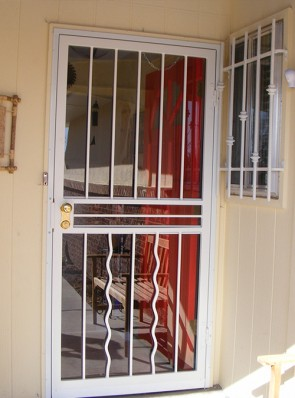 Security storm door with alternating Wave  pickets on bottom