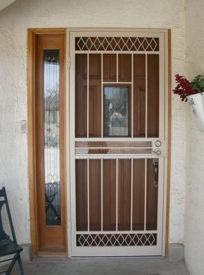 Security storm door with Diamond design on top and bottom