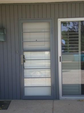 Security storm door in horizontal pickets design