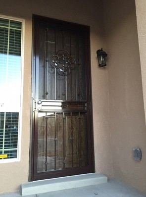 Security storm door in Knuckles design with top Forged scroll