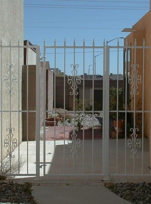 6' high gate and fence with spears and Seville design