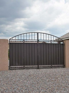 Pr. of gates with arched top, High Desert design and solid metal