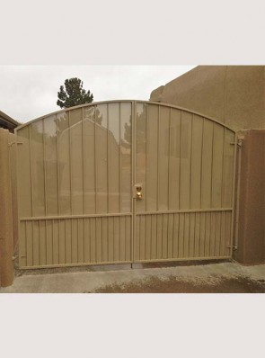 Arched gates with doggie pickets and perforated metal