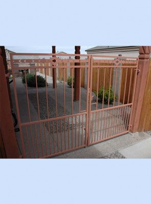Double gates with doggie pickets and high desert design on top