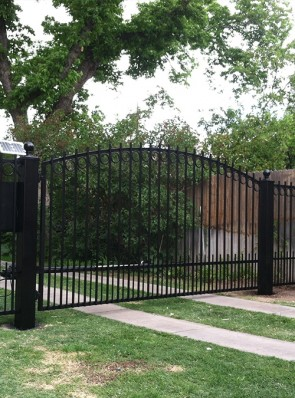 Driveway automatic gate with Circles, and doggie pickets