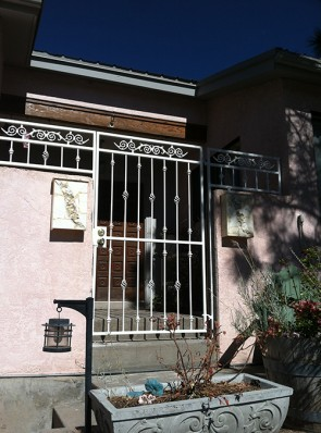 Courtyard gate and wall topper with knuckles and baskets design and scroll design on top
