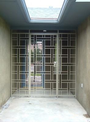 Porch enclosure in basketweave design