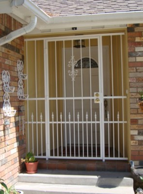 Porch enclosure with Sundance design and doggie pickets with spears