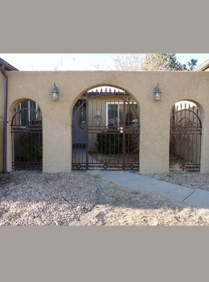 Arched porch enclosure with spears, and High Desert design