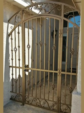 Arched porch enclosure with forged scrolls, Knuckles, Baskets design
