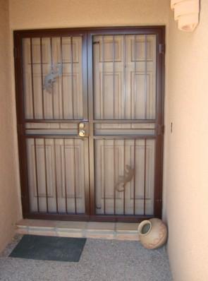Pair of security screen doors with 2 geckos
