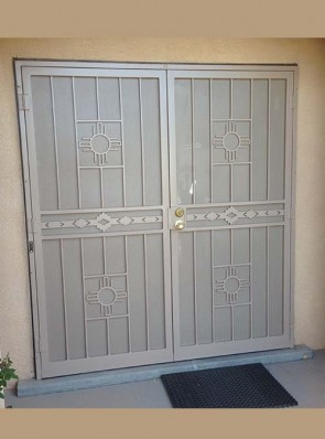 Pair of security pre hung doors with perforated metal in medium zia design and high desert in center