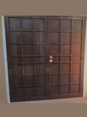 """Pair of security pre hung doors with perforated metal in 3/4"""" divided light with cross strap design"""