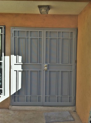 Pair of security pre hung doors with perforated metal in simple shadow box design