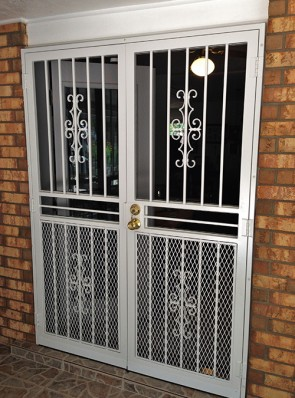 "Pair of security pre hung doors in seville design with 3/4"" expanded metal on bottom and screens"