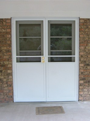 Pair of security screen doors without pickets on the top and solid panel on bottom