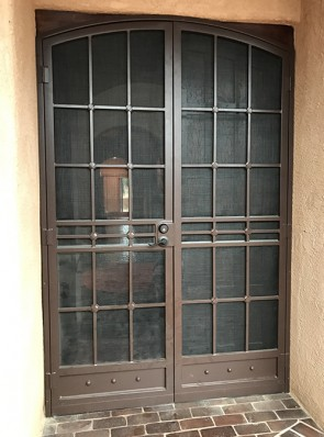 "Pair of arched security pre-hung screen doors in 3/4"" Divided Light with Cross Strap and kick panel design"
